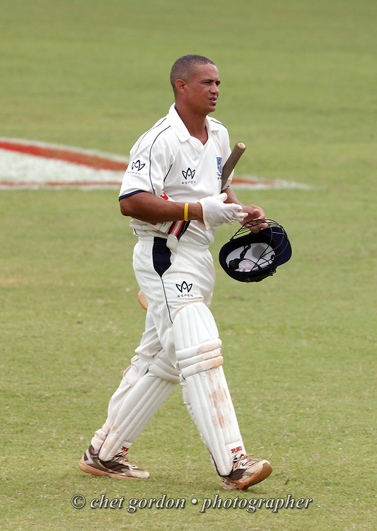 St. George's batsman Lionel Cann walks off the pitch after making an out against Somerset during the first day of Cup Match at the St. George's Cricket Club in St. George's, Bermuda on Thursday, July 28, 2011. The 109th. Annual Cup Match takes place during the two day public holidays of Emancipation Day and Somers Day in Bermuda.