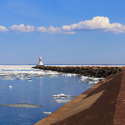 &quot;Marquette Breakwater Lighthouse&quot;<br /> <br /> Scenic Marquette Michigan on a beautiful late spring day with icebergs still afloat on Lake Superior at Presque Isle Harbor!The long jetty and lighthouse stretching into the distance!