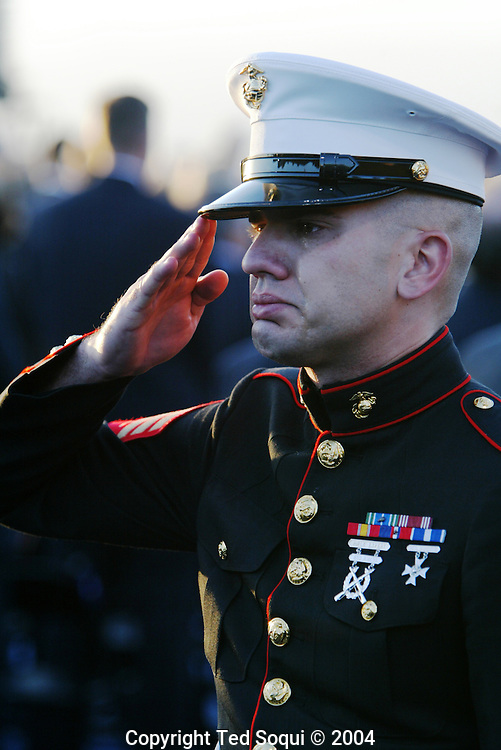 Marine Sgt. Ethan E. Rocke saluting and crying as Ronald Reagan is buried..Ronald Reagan Presidential Library..Simi Valley, CA 6/11/04.