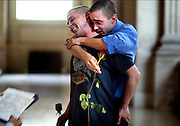 Frank Capley, 29, and Joe Alfano, 33, are filled with emotion as they are married. Same-sex marriage ceremonies were allowed at City Hall in San Francisco until it was stopped by court order.
