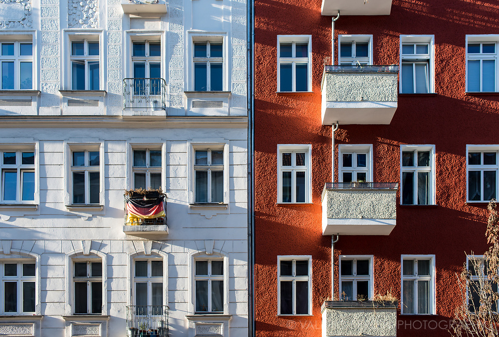 Buildings in East Berlin with a german flag on a balcony.