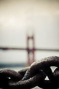 The  Golden Gate Bridge early in a misty evening, as seen from Crissy Field, San Francisco, California, USA.