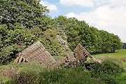 Collapsed shed in a field near Postlip, Gloucestershire