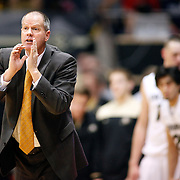 SHOT 1/21/12 7:04:23 PM - Colorado head basketball coach Tad Boyle coaches against Arizona during their PAC 12 regular season men's basketball game at the Coors Events Center in Boulder, Co. Colorado won the game 64-63..(Photo by Marc Piscotty / © 2012)