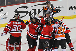 Jan 22, 2013; Newark, NJ, USA; The New Jersey Devils and Philadelphia Flyers fight after a goalie interference by Philadelphia Flyers right wing Wayne Simmonds (17) during the second period at the Prudential Center.