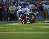 Ole Miss wide receiver Donte Moncrief (12) makes a catch as Central Arkansas' Karl Brady (1) defends at Vaught-Hemingway Stadium in Oxford, Miss. on Saturday, September 1, 2012. (AP Photo/Oxford Eagle, Bruce Newman)..