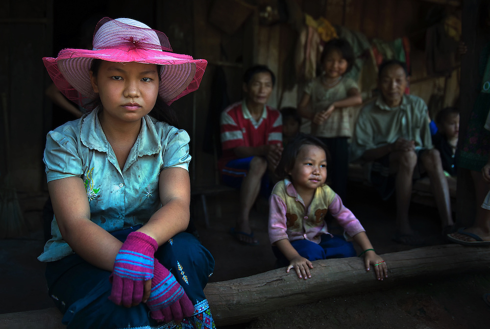 A Hmong family at home near Luang Prabang, Laos.