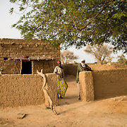 Raga Djibril with her son, Oumarou Ambuta, at her home in the village of Gadirga in the Commune of Soukoukoutan in the Dosso Region of Niger on 23 July 2013.