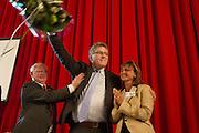 Henk Krol wordt door Jan Nagel (links) en Martine Baay (rechts) gefeliciteerd met zijn verkiezing tot lijsttrekker. In Hilversum houdt de 50Plus partij haar verkiezingscongres. Tijdens het partijcongres wordt Henk Krol gekozen tot de lijsttrekker. Jan Nagel is de partijvoorzitter.<br /> <br /> Jan Nagel (left) and Martine Baay congratulate Henk Krol with his election as leader. The 50Plus party, a political party aiming mostly at the people of 50 years and older, is having its congress in Hilversum. Henk Krol, former chief editor of the Gaykrant, is elected as leader. Jan Nagel is the chairman.