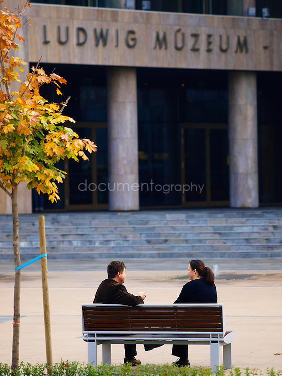 People having a chat in front on modern art Ludwig Museum, Budapest, Hungary.