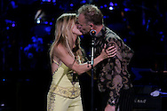 Singers Sheryl Crow and Sting(R) perform during the Rainforest Foundation's benefit concert at Carnegie Hall in New York May 19, 2006. Photo by Keith Bedford