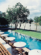View of the pool and the Ping River at The Chedi, Chiang Mai