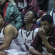 Caravel Academy O'Koye Parke (24), CENTER, wince in pain during a regular season high school basketball game between Caravel Academy and St. Thomas More Sat. Jan. 14, 2016 at Caravel Academy in Bear.