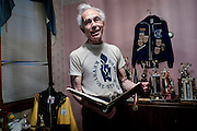 Tony Gennaro, 84, stands in a room full of his weightlifting trophies and memorabilia in his home in West Aliquippa. Gennaro, a weightlifter who held both national and world titles is a former steelworker that worked in the blooming mill at the J&L facility in Aliquippa.