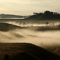 September 18, 2009. Hindman, Kentucky. Morning fog fills the valleys between the man-made contours of Combs Branch reclaimed surface coal mine. (Credit image: © David Stephenson/ZUMA Press)