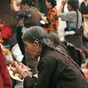 Pilgrims come daily to pray in front of the Jokhang Temple, the most revered religious structure in Tibet. The Barkhor, Lhasa, Tibet. 8/7/05.
