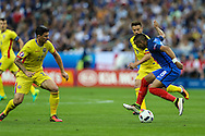 SAINT-DENIS, FRANCE, 10.06.2016 - FRANCE-ROMANIA - Dimitri Payet of France dispute the ball with Cristian Sapunaru of Romania, in a match valid for the 1st round of Group A of Euro 2016 in the Stade de France in Saint-Denis , on Friday (10)