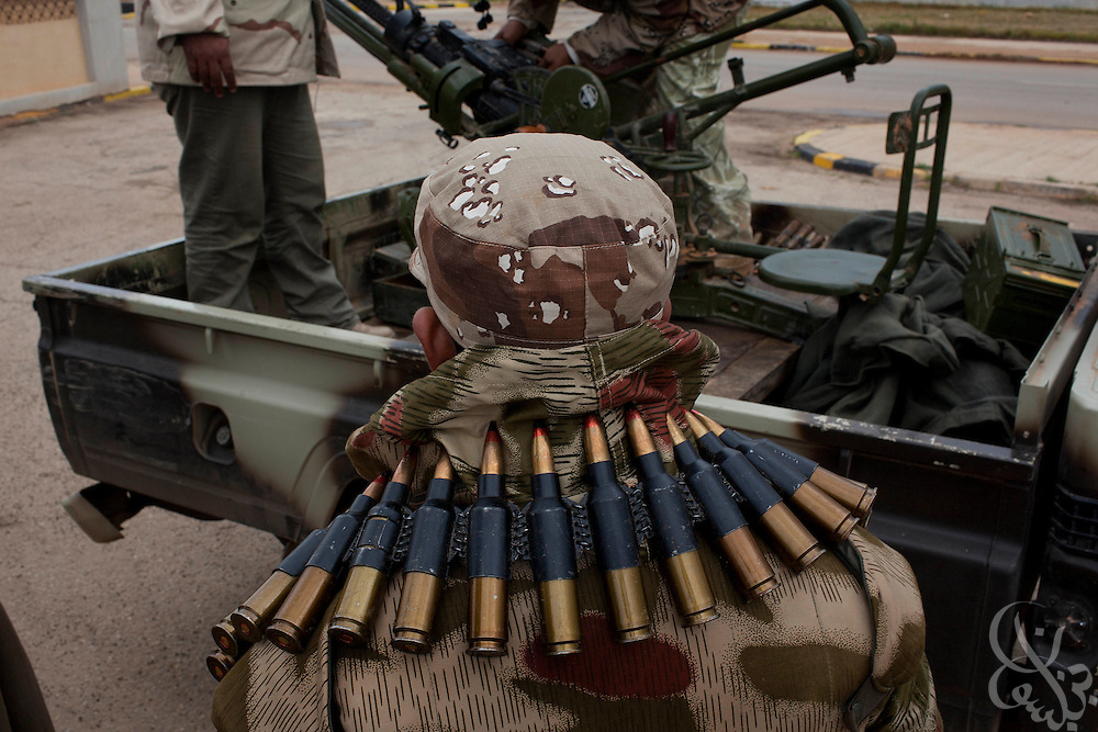 A defected Libyan paratrooper take stock of equipment at their base February 26, 2011in Benghazi, Libya. There are unconfirmed reports a rebel force, made up of defected soldiers and volunteers,  is moving closer to the capital Tripoli..Slug: Libya.Credit: Scott Nelson for the New York Times