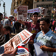 Egyptian Socialists hand out party newspapers and brochures as they take part in a large July 8, 2011 protest in Tahrir Square in downtown Cairo, Egypt. The rally was an opportunity to reinforce the demands of the original revolution while also giving smaller or newer parties a platform to help spread their message to the tens of thousands who had gathered. (Photo by Scott Nelson/Der Spiegel).