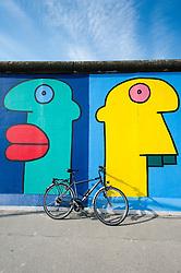 Colourful murals at East Side Gallery at former Berlin Wall in Friedrichshain/Kreuzberg in Berlin Germany