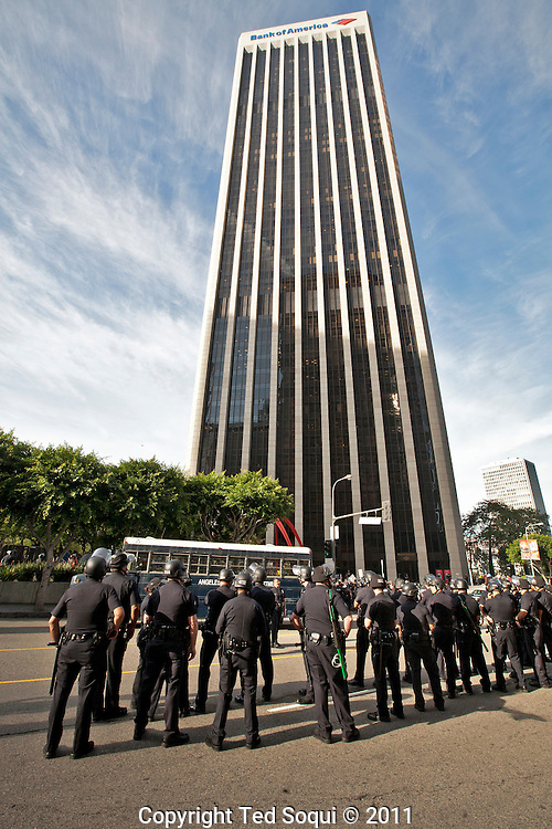 Hundreds of protesters from Occupy LA and several other organizations held a rally and march in downtown L.A.'s financial center. <br /> The march ended at the Bank of America building where several protesters were arrested for trespassing.Today is a 'National Day of Action,' and many cities around the U.S. held similar types of rallies and marches.