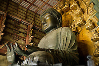 """The Great Buddha of Nara belongs to Todaiji Temple, located in the ancient capital of Nara.  The construction of Todaiji, was completed in 752 with the aim, not only to house the Great Buddha image, but also to consolidate the position of the city as Japan's capital and powerful center of Buddhism. The Great Buddha Hall, called """"Daibutsu-Den"""", the main hall of Todaiji, was rebuilt several times. The current structure, completed in 1709, is only two-thirds of the original size, but is still the largest wooden building in the world. The seated figure inside is the world's largest bronze image of Buddha. The Historic Monuments of Ancient Nara were registered as UNESCO World Cultural Heritage site."""