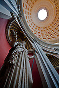 Oculus and stone statue, Vatican Museum, Vatican City, Rome, Italy