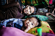 Bajau mother and her youngest son in their pile dwelling on Omadal Island