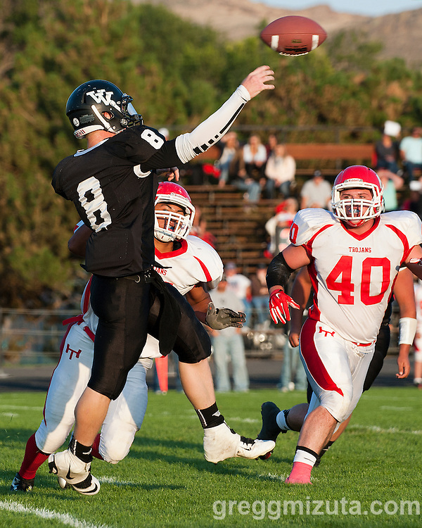 Vale's Josh Schoorl releases the pass under pressure from a charging Amos Aquilera during the Vale - Homedale football game, September 12, 2014 at Frank Hawley Stadium, Vale, Oregon. Vale won 33-20 to improve their record to 2-0.