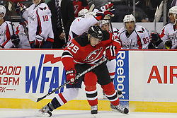 Jan 25, 2013; Newark, NJ, USA; New Jersey Devils defenseman Mark Fayne (29) avoids a hit from Washington Capitals right wing Eric Fehr (16) during the second period at the Prudential Center.