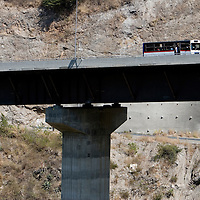 Bus passing across the venezuelan major bridge called viaduct #1. This bridge is the key route to the country's main airport in Venezuela. Feb 27 2008. (ivan gonzalez).