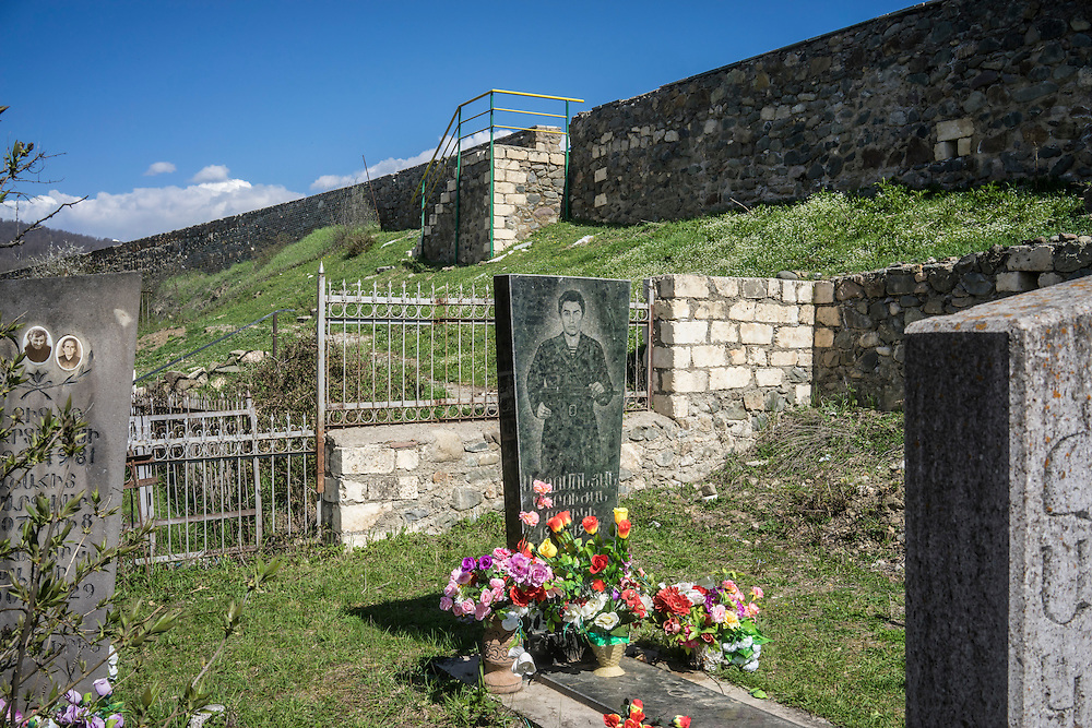 MARTAKERT, NAGORNO-KARABAKH - APRIL 18: The grave of a man killed fighting in the Armenia-Azerbaijan war over Nagorno-Karabakh at Gandzasar Monastery on April 18, 2015 in Martakert, Nagorno-Karabakh. Since signing a ceasefire in a war with Azerbaijan in 1994, Nagorno-Karabakh, officially part of Azerbaijan, has functioned as a self-declared independent republic and de facto part of Armenia, with hostilities along the line of contact between Nagorno-Karabakh and Azerbaijan occasionally flaring up and causing casualties. (Photo by Brendan Hoffman/Getty Images) *** Local Caption ***