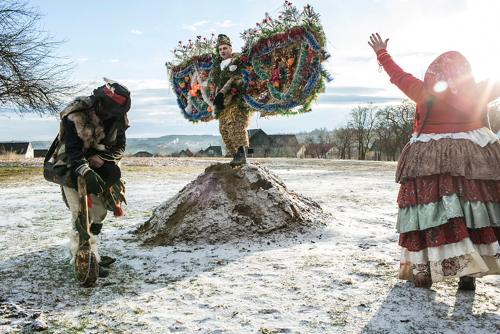 Petro Dragun, 18, center, in an elaborate bear costume, celebrates the Malanka Festival on Thursday, January 14, 2016 in Krasnoilsk, Ukraine. The annual celebrations, which consist of costumed villagers going in a group from house to house singing, playing music, and performing skits, began the previous sundown, went all night, and will last until evening.