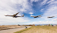 Nippon Cargo jet landing at Ted Stevens Anchorage International Airport in Southcentral Alaska with the Chugach Mountains in the background. Spring. Afternoon.