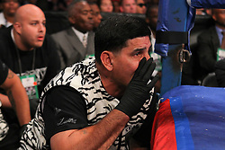 Oct 19, 2012; Brooklyn, NY, USA; Angel Garcia, father/trainer of WBC/WBA super lightweight champion Danny Garcia shouts instructions during his son's bout against Erik Morales at the Barclays Center. Garcia won via 4th round KO.