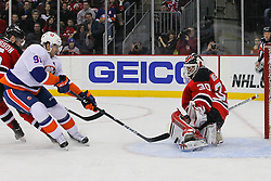 Jan 31, 2013; Newark, NJ, USA; New Jersey Devils goalie Martin Brodeur (30) makes a save on New York Islanders center John Tavares (91) during the first period at the Prudential Center.
