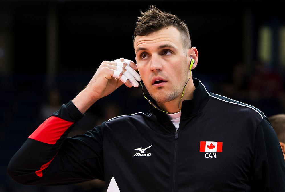 Gavin Schmitt of Canada warms up prior to a World League Volleyball match versus Korea at the Sasktel Centre in Saskatoon, Saskatchewan Canada on June 24, 2016.