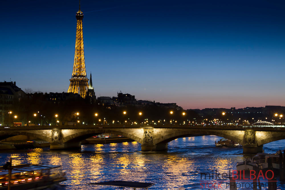 Eiffel Tower and Seine river from Alexandre III bridge at sunset.<br /> Paris, France, Europe.
