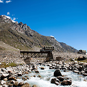 Army trucks cross a bridge in Lahaul valley, Himachal Pradesh, India