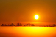 NOV 12, 2009: Sunrise in rural Ohio with fog over field.