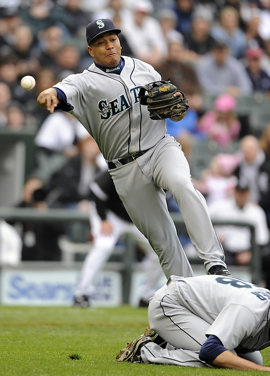 CHICAGO - APRIL 24:  Jose Lopez #4 of the Seattle Mariners rmakes an off balance throw against the Chicago White Sox on April 24, 2010 at U.S. Cellular Field in Chicago, Illinois.  The White Sox defeated the Mariners 5-4.  (Photo by Ron Vesely)