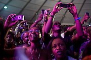 Nigerian fans take photos of pop star Rihanna as she performs during the 3rd Annual THISDAY music and fashion festival July 11, 2008 in Abuja, Nigeria. Pop stars Jay-Z and Usher also participated in the Abuja leg of the event, an annual festival designed to raise awareness of African issues while promoting positive images of Africa using music, fashion and culture in a series of concerts and events in Nigeria, the United States and the United Kingdom. .
