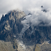 The Needles of Chamonix (Les Aiguilles du Chamonix), rise high above the city of Chamonix-Mont-Blanc, France, Europe.