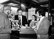 One of the most flamboyant and controversial heroes in the history of soccer, Derek Dougan signs copies of his autobiography, Doog, for customers at Hodges Figgis, Stephen&rsquo;s Court, Dublin. Photo shows one of the first customers, Peter Moynihan of Sandyford, County Dublin, as well as Robert Twigg, Manager, Hodges Figgis, and Norma Doyn, cashier.<br />16 April 1980