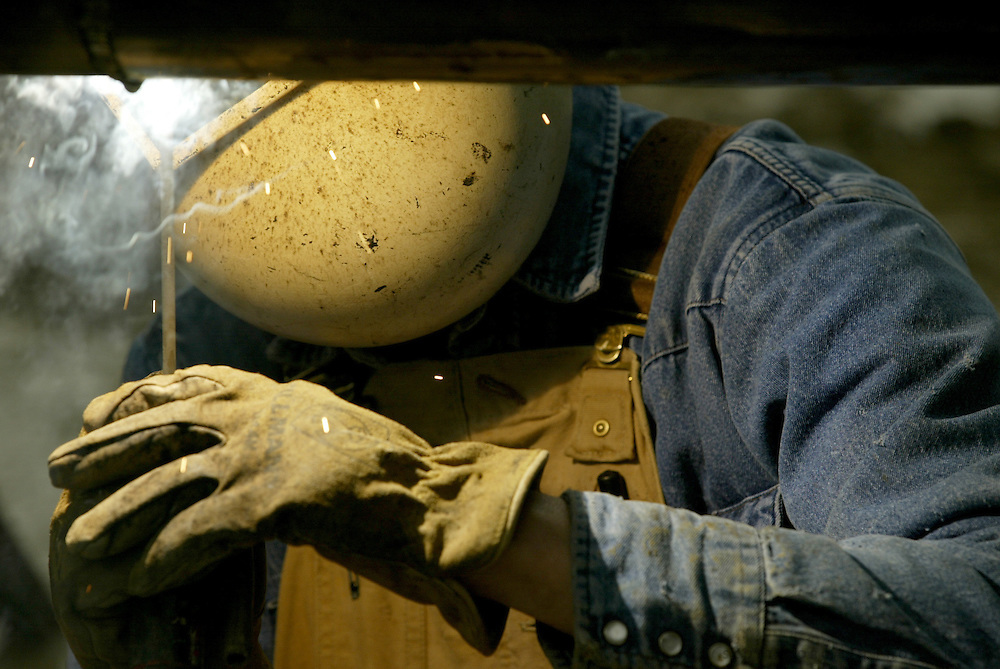 Steven Abbott of Manito, Ill. welds a water pipe Tuesday, November 11, 2004, which will carry water into the ethanol plant.