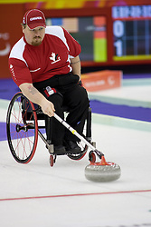 PINEROLO, ITALY - MARCH 15th : Team Canada skipper Chris Daw lines up a stone during the last round-robin match of the curling competition between Canada and Italy during Day 5 of the Turin 2006 Winter Paralympic Games on March 15th, 2006 at the Pinerolo Palaghiaccio Stadium in Turin, Italy.