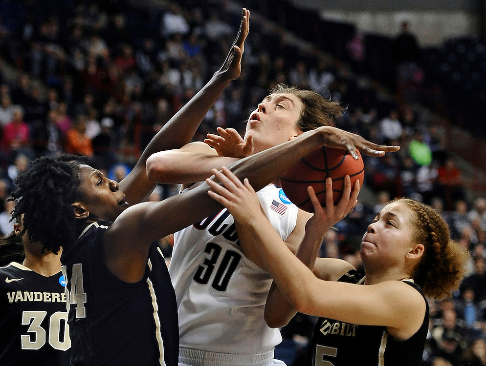 Connecticut's Breanna Stewart, center is fouled by Vanderbilt's Tiffany Clarke, left,  as Vanderbilt's Jasmine Jenkins, right, defends in the second half of a second-round game in the women's NCAA college basketball tournament in Storrs, Conn., Monday, March 25, 2013. Connecticut won 77-44. (AP Photo/Jessica Hill)