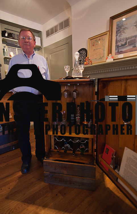 01/19/12 Historic New Castle DE: Designer Ken Sturgis of Snickers Ditch Trunk Company standing next a bar trunk that was hand made by Ken Thursday, Jan. 19, 2012 in Historic New Castle Delaware.<br /> <br /> Special to The News Journal/SAQUAN STIMPSON