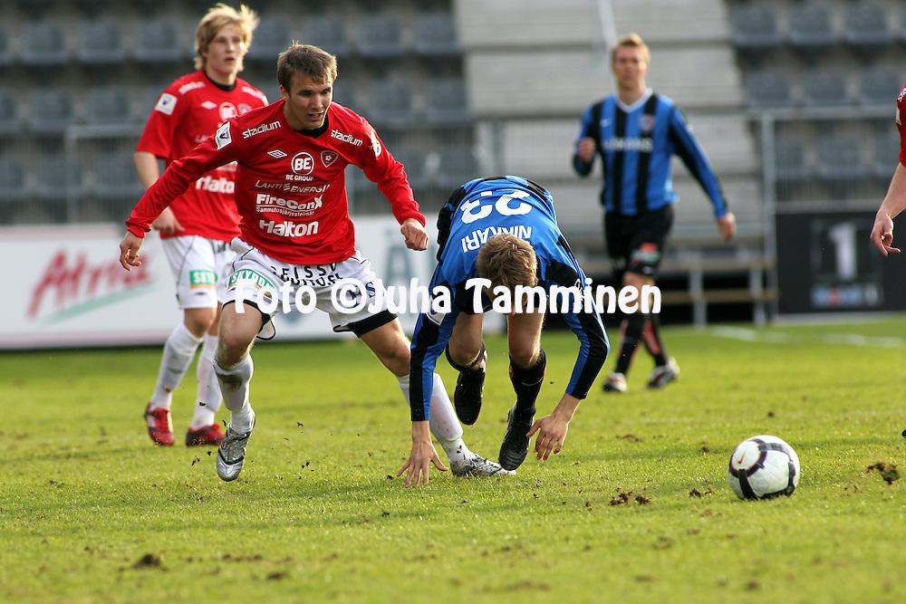 03.05.2010, Kupittaa, Turku..Veikkausliiga 2010, FC Inter Turku - FC Lahti..Jarkko V?rtt? (FC Lahti) v Ville Nikkari (Inter).©Juha Tamminen.