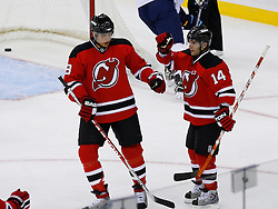 Nov 1, 2008; Newark, NJ, USA; New Jersey Devils right wing Brian Gionta (14) and New Jersey Devils center Dainius Zubrus (8) celebrate Gionta's goal during the second period at the Prudential Center.